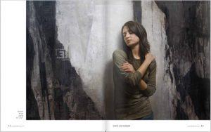 peinture à l'huile de D.Kassan : femme contre un mur