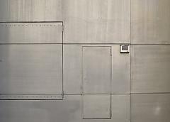 photo d'un mur lisse avec une porte